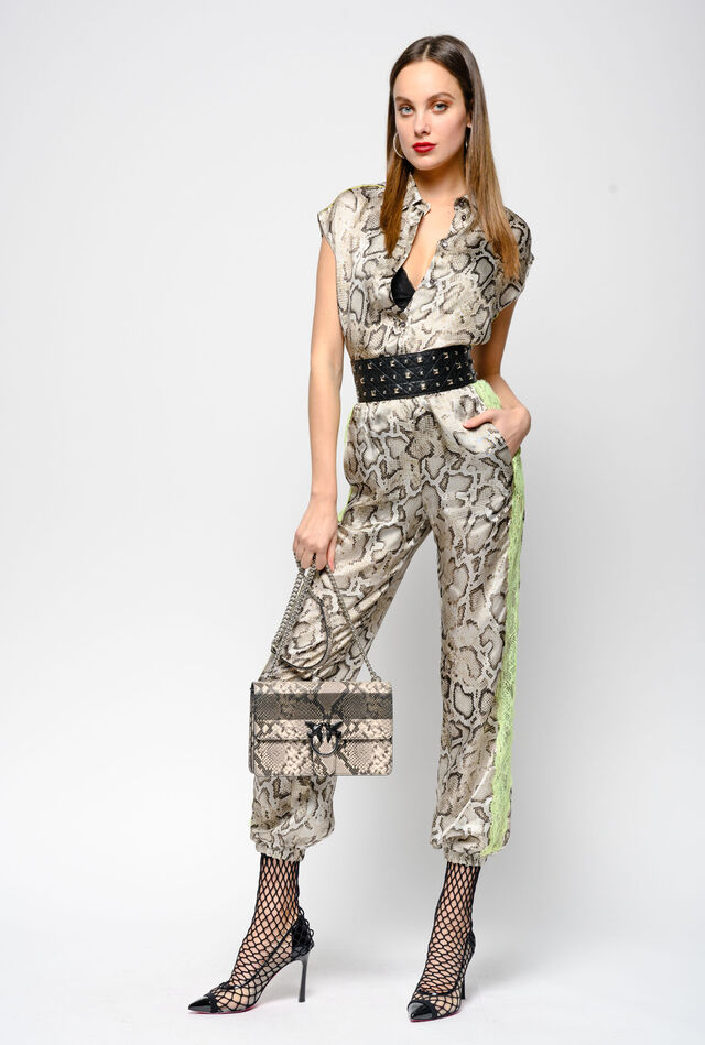 Trousers in snake print twill