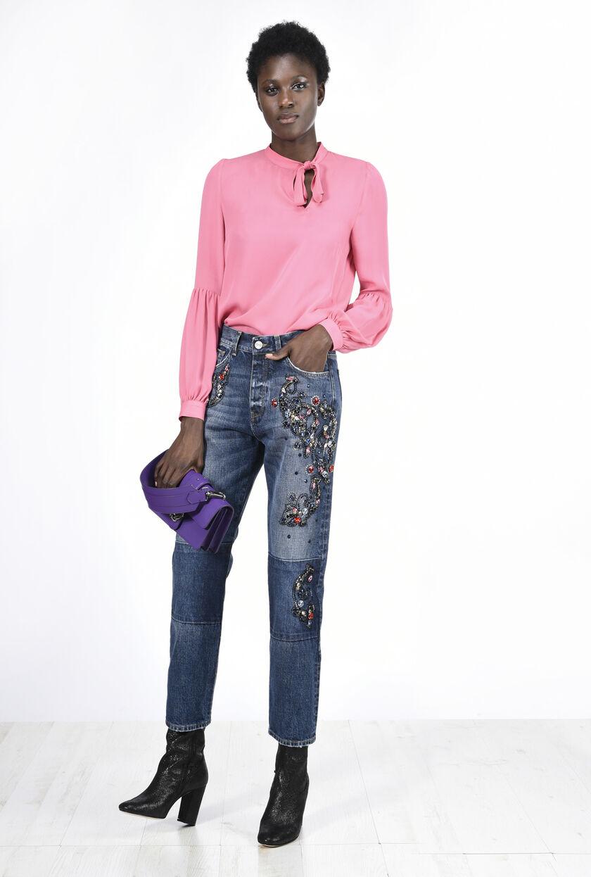 Jeans denim con applicazioni