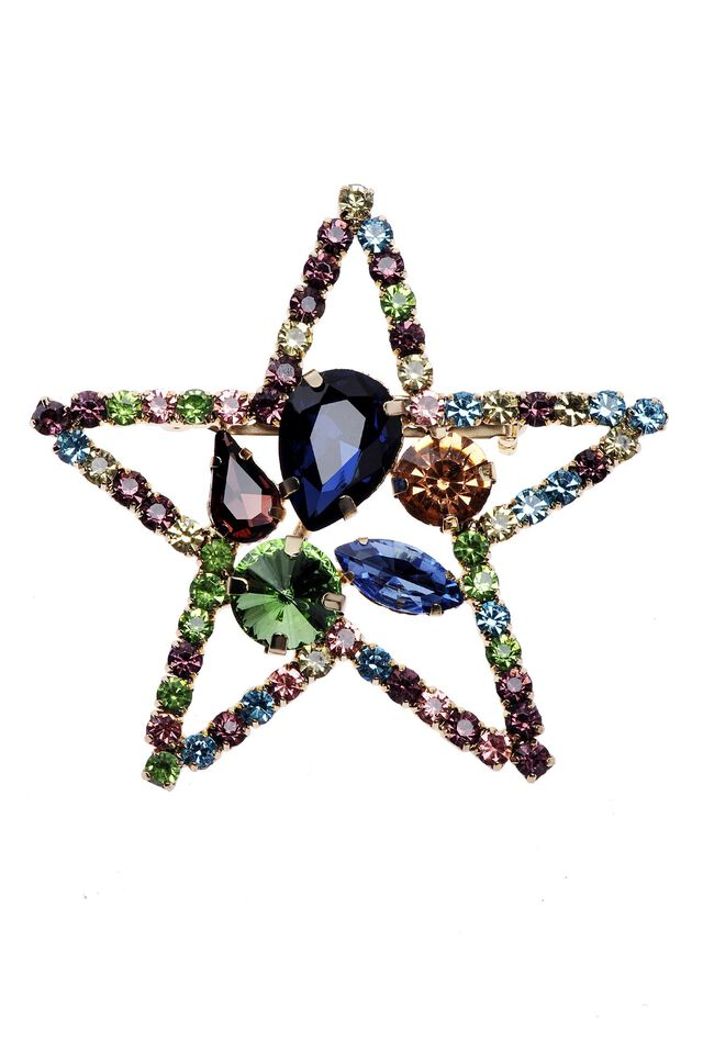 Star-shaped brooch with rhinestones