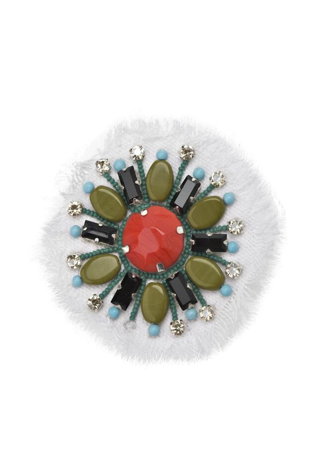 Fabric brooch with flower-shaped stones and settings