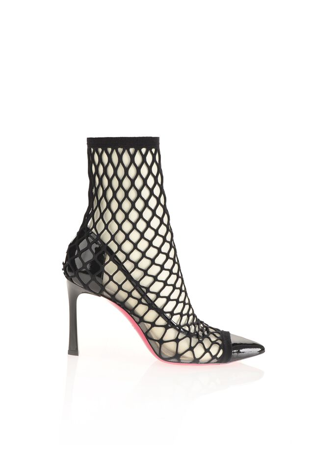 Patent leather pumps with fishnet socks