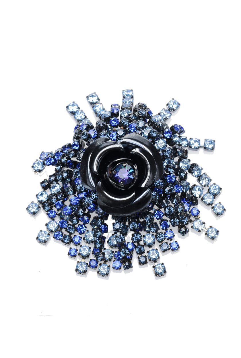 Metal and rhinestone brooch