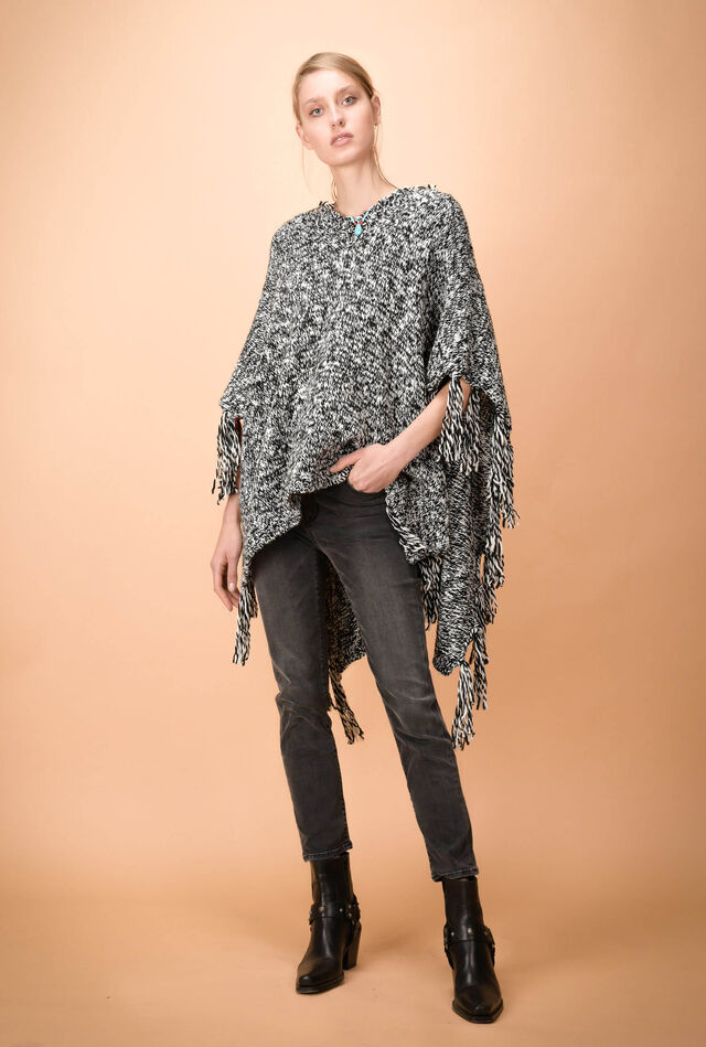 Mélange poncho with fringes and colour-contrast detail