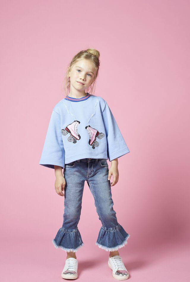 Five-pocket denim-look fleece trousers with flounces