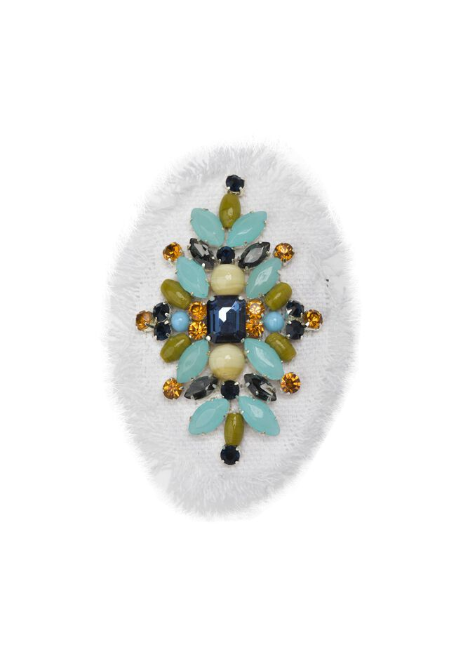 Oval fabric brooch with flower-shaped stones and settings